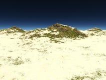 Den steniga terrängen som täckas med sand Arkivfoton