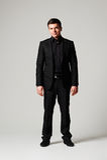 Den stilfulla manen i svart passar Royaltyfri Bild