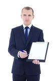 Den stiliga affärsmannen i skrivplatta för dräktinnehavmellanrum isolerade nolla royaltyfria bilder