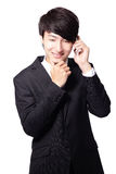 Den stiliga affärsmanen som använder mobil, ringer Royaltyfri Foto