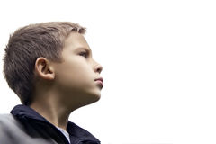 Den stiliga pojken ser stadigt in i framtiden arkivfoto