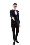 Den stiliga unga affärsmannen sträcker ut hans hand för att introducera H Royaltyfri Bild
