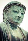 Den stora Buddha (Daibutsu) på jordningen av den Kotokuin templet i Kamakura, Japan Royaltyfria Foton