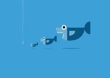 Den stora fisken äter den lilla fisken Arkivbild