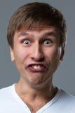 Den stora head grabben gör galna framsidasinnesrörelser Arkivfoto