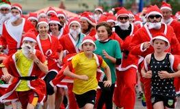 Den stora KidsCanen Santa Run Auckland Central Fotografering för Bildbyråer