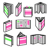 Den stora uppsättningen av den stilfulla svarta översikten bokar i olika ställingar med färgrika rosa och gröna beståndsdelar Arkivfoto