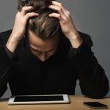 Stressad affärsman Fotografering för Bildbyråer
