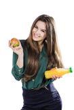 Den sunda flickan med vatten och äpplet bantar att le som isoleras på vit Fotografering för Bildbyråer