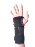 Den svarta handleden spjälkar för den manliga modellen för assistenten Arkivbilder