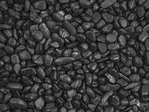 Den svarta kiselstenen stenar bakgrund Arkivbild