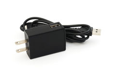 Den svarta proppen och usb till mini- usb kablar Royaltyfri Foto