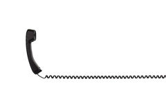 Den svarta telefonluren med en vriden tråd som horisontellt sträcks Royaltyfri Foto