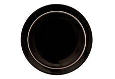 Den svartvita matställen pläterar. royaltyfri fotografi