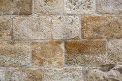 Den texturerade fyrkanten förundra sig väggen Royaltyfri Bild