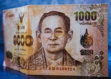 Den thailändska sedeln värderade tusen baht royaltyfri foto