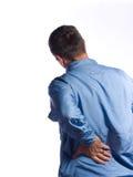 den tillbaka mannen smärtar Arkivfoto