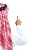 Den tillbaka sikten av emirater för en arabsaudier man att välja i luften fotografering för bildbyråer