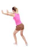 Den tillbaka sikten av kvinnan skjuter väggen Arkivfoto