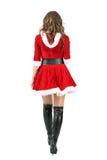 Den tillbaka sikten av kvinnlign Santa Claus i röd jul klär att gå bort royaltyfria foton