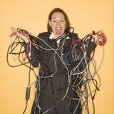 den tilltrasslade holdingen wires kvinnan Royaltyfria Foton