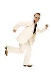 Den tokiga diskodansare i vit passar och slingrar läderkängor Royaltyfria Bilder