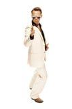 Den tokiga diskodansare i vit passar och slingrar läderkängor Arkivbilder