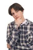 Den tonårs- pojken tvivlar Arkivbild