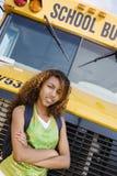 Den tonårs- kvinnliga studenten Standing With Arms korsade Fotografering för Bildbyråer