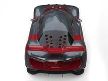 Den toppna sportbilen - kritisera grå färger med metalliska körsbärsröda röda sidopaneler och fostra vingen royaltyfri illustrationer