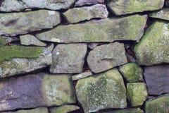 Den torra stenväggen texturerar bakgrund Royaltyfria Foton