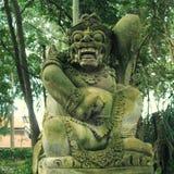 Den traditionella demonstenen sned statyn i Ubud, den Bali ön, Indo Arkivbilder