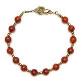 Den trevliga halsbandet med röda pärlor på vit bakgrund Royaltyfria Bilder