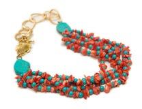 Den trevliga halsbandet med röda pärlor på vit bakgrund Royaltyfria Foton