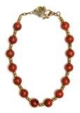 Den trevliga halsbandet med röda pärlor som isoleras på vit bakgrund Royaltyfria Foton