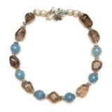 Den trevliga halsbandet på vit bakgrund Royaltyfria Foton