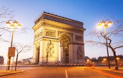 Den triumf- bågen i afton, Paris Fotografering för Bildbyråer