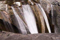 Den Trois Roches vattenfallet Arkivbild
