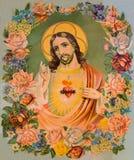Den typiska katolska bilden av hjärta av Jesus Christ i blommorna från Slovakien skrivev ut i Tyskland från slutet av 19 cent Royaltyfria Bilder