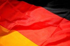 Den tyska flaggan Arkivbild