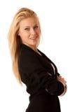Den unga affärskvinnan med blont hår och blåa ögon som gör en gest framgångvisning, tummar upp isolerat över vit Royaltyfria Foton