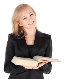 Den unga affärskvinnan med bokar över vitbakgrund Fotografering för Bildbyråer