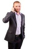 Den unga affärsmanen på mobil ringer Arkivfoto