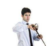 Den unga affärsmannen drar ett svärd Royaltyfri Bild