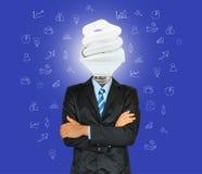 Den unga affärsmannen har ett huvud som lampan med kreativitet för succes royaltyfri fotografi