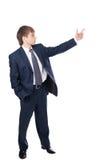 Den unga affärsmannen visar pekfingrar Arkivfoton