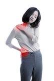 Den unga asiatiska affärskvinnan fick smärtar tillbaka royaltyfria bilder