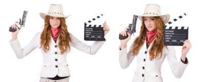Den unga cowgirlen med vapen- och filmbrädet som isoleras på vit Royaltyfri Foto