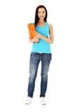 Den unga deltagarekvinnan med henne bokar Arkivbild