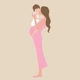 Den unga gravida kvinnan med behandla som ett barn design Royaltyfri Bild